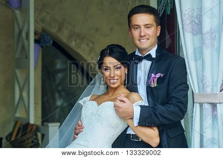 Wedding day romantic couple portrait of young couple in city