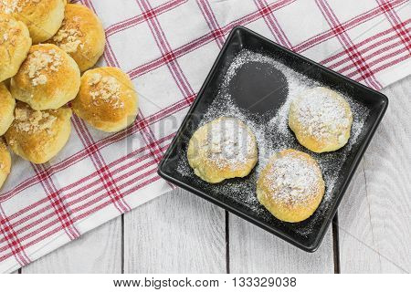 Top View On Sugared Czech Traditional Wedding Curds Cakes On A Black Tray, One Missing