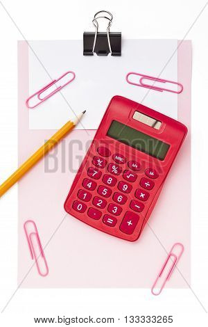 View Of A Clip Board With Paper Clip Calculator And Pencil