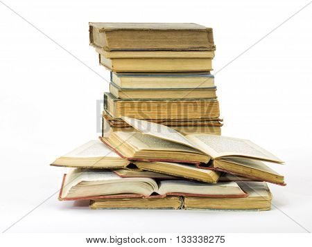 Old books pile vertical isolated on a white background