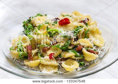 pasta orecchiette with ruccola and bacon