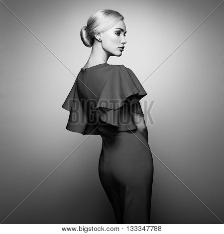 Fashion portrait of elegant woman with magnificent hair. Blonde girl. Perfect make-up. Girl in elegant dress. Girl posing. Studio photo