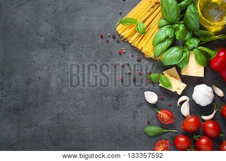 Pasta ingredients. Ingredients for cooking Italian pasta - spaghetti tomatoes basil oil and garlic. Italian food. Top view with space for text.