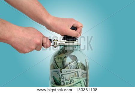 man preserves the American currency in a glass jar
