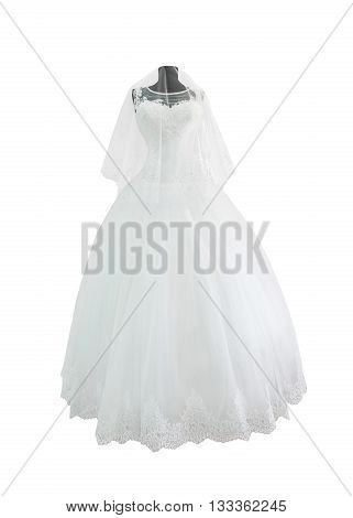 White wedding dress with veil on mannequin isolated on white background