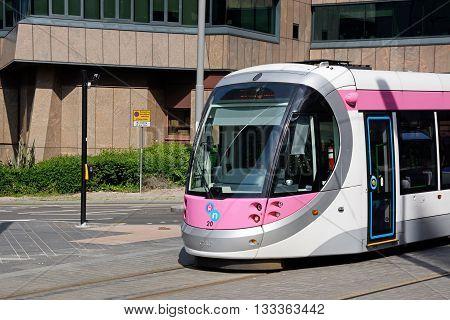 BIRMINGHAM, UK - JUNE 6, 2016 - Midland Metro city centre extension Tram along Colmore Circus Birmingham England UK Western Europe, June 6, 2016.