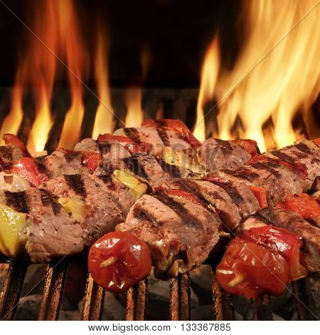 Homemade Kebabs On The Bbq Flaming Charcoal Grill