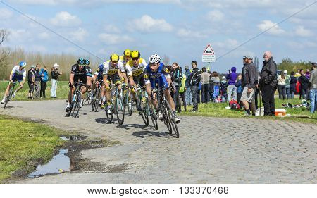 Hornaing France - April 102016: The German cyclist Tony Martin of Etixx-Quick Step Team riding in the peloton on a paved road in Hornaing France during Paris Roubaix on 10 April 2016.