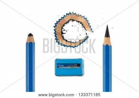 Sharp and unsharp blue pencils isolated on white background. Dirty blue sharpener and pencil shavings with dust in the center.