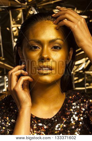 Woman With Golden Makeup And Bodyart