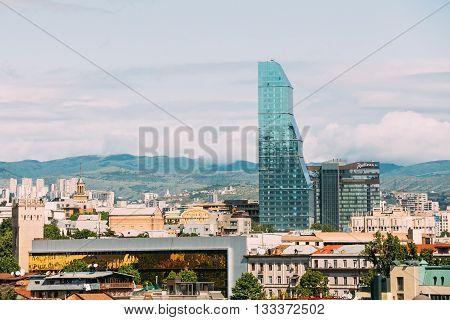 Tbilisi, Georgia - May 19, 2016: Radisson Blu Hotel On Background Of Urban Cityscape Of Tbilisi, Georgia