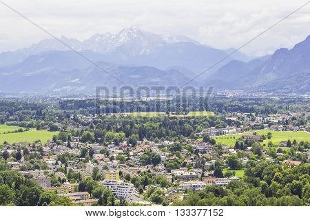 background landscape view of the snowy peaks and the city below of the Alps from the observation deck of Bolzano, Tyrol, Trentino, Italy