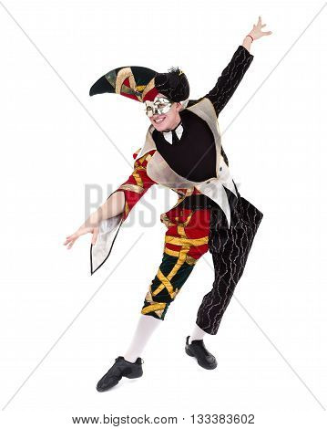 Smiling harlequin wearing a mask, isolated on white background in full length.