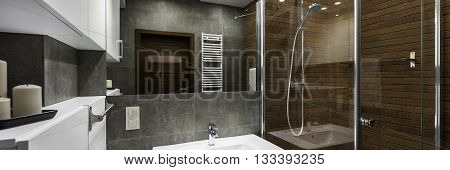 Modern bathroom interior designed in white grey and brown panorama