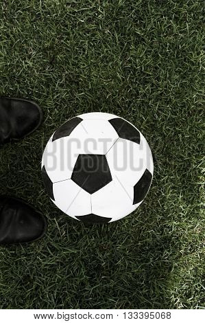 football in the green grases with preset
