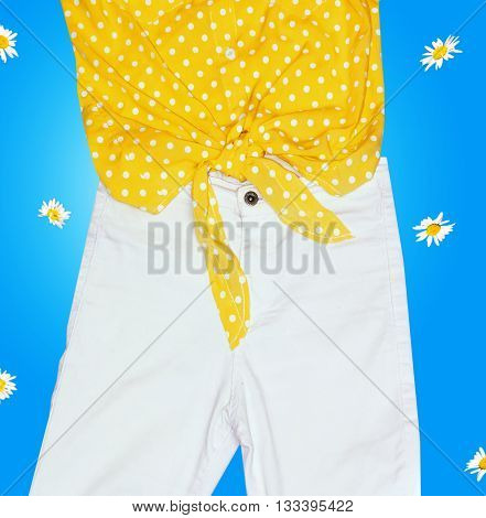 bright yellow shirt with knot and white jeans for bright blue background with daisies