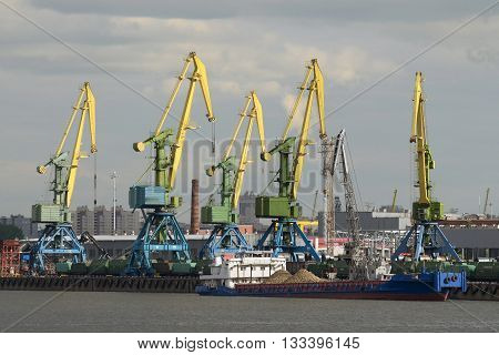 Russia.The port in St. Petersburg.Loading of ships with different cargo in the port is performed every day.