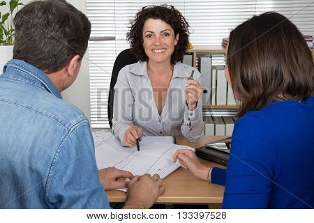 Smiling Woman Realtor Giving Key Of New Apartment To Client.