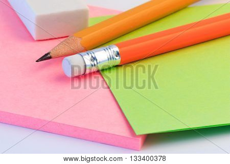 Pencil, Eraser And A Paper Note Up Close. Simple Pencil, Eraser And Paper Note.