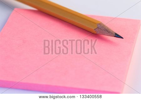 Pencil And A Paper Note Up Close. Simple Pencil And Paper Note. Closeup Pink Paper Note Of Sketch Wi