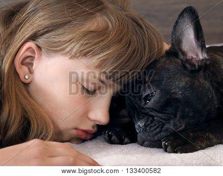 Girl and dog face to face. She sleeps. Friendship girl and dogs. The concept of friendship, love, trust and human animal