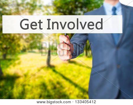 Get Involved - Businessman Hand Holding Sign