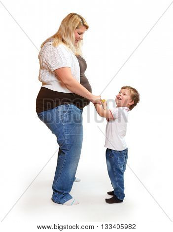 Overweight or pregnant mother with her son have a fun. Healthy lifestyle concept. Children and adults on white background. Happy family together.