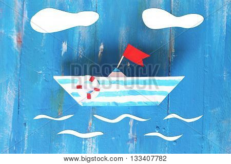Photo of cute origami paper boat on wooden background