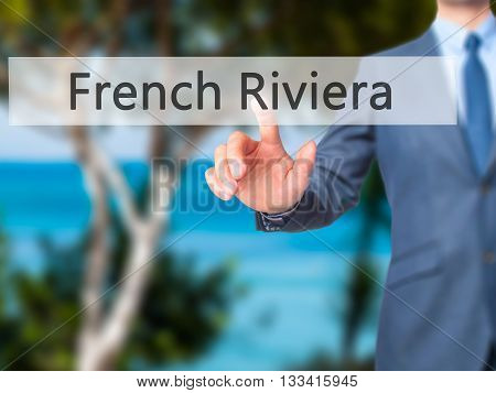 French Riviera - Businessman Hand Pressing Button On Touch Screen Interface.