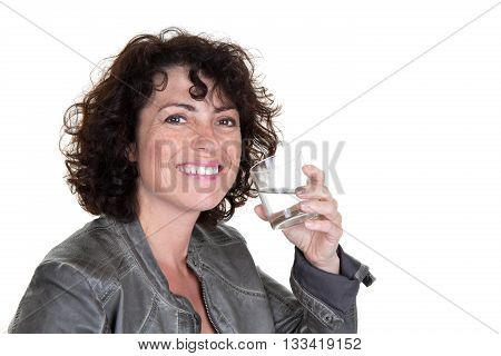 Woman Drinks Water From A Glass And Smiling At The Camera