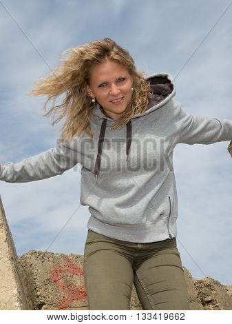 Happy Blonde Woman Smiling Under Blue Sky