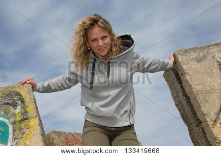 Blonde Woman Smiling In A Casual Clothes Under Blue Sky