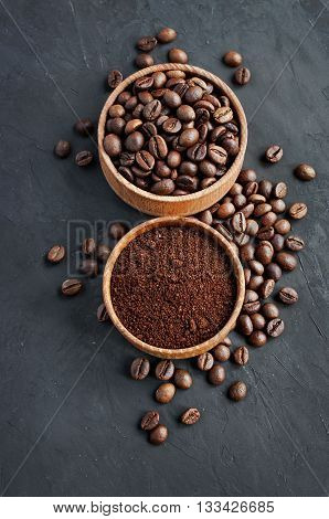 Coffee Beans And Ground Coffee In A Wooden Bowl