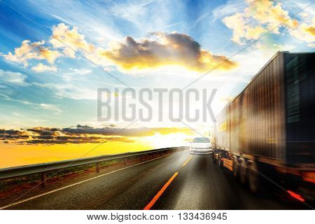 Truck driver blinded by the sun moving a collision course.
