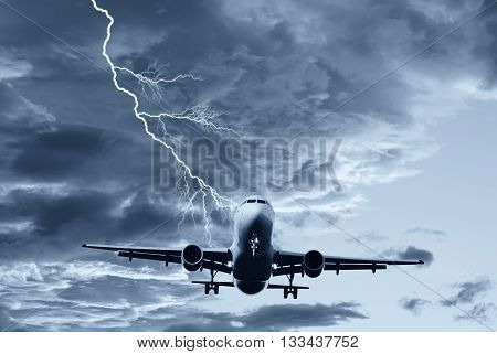 airplane in the sky with lightning during the storm