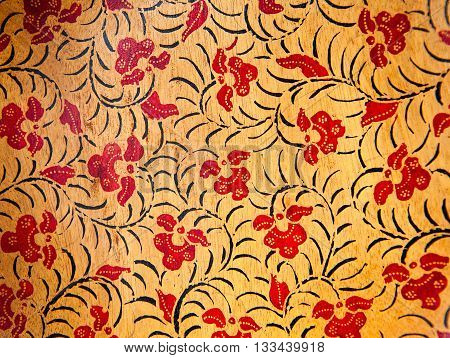 gold background with red textured floral ornaments