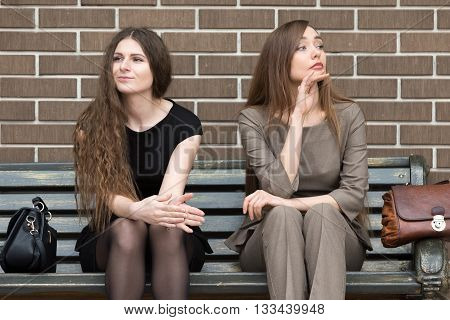 Two Young Beautiful Female Rivals On Bench
