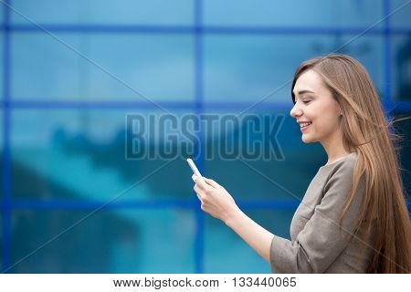Portrait Of Business Woman Sending Phone Message. Copy Space