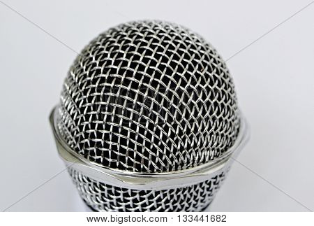 Stereo silver karaoke microphone close up on a white background