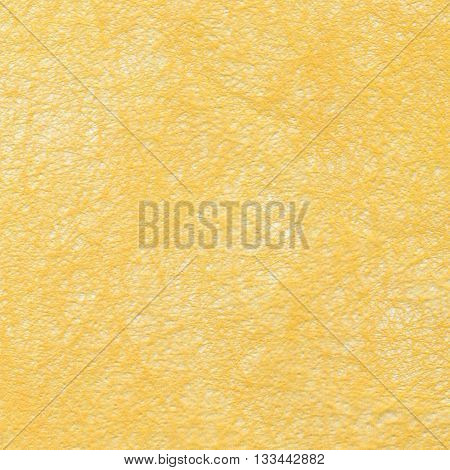Blank piece of yellow paper as background. Close-up.