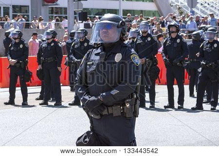 SAN DIEGO USA - MAY 27 2016: San Diego police officers stand in riot gear at an anti-Trump demonstration outside a Trump rally at the San Diego Convention Center.