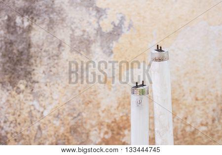 Selected focus fluorescent light tube.Short depth-of-field. Old fluorescent light tube with grunge wall background