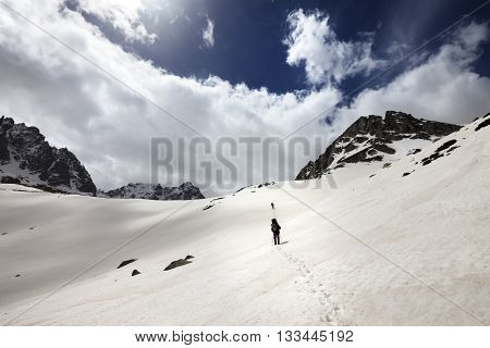 Two hikers in snowy mountains. Turkey Kachkar Mountains highest part of Pontic Mountains. Wide angle view.