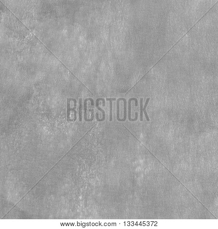 Blank piece of gray paper as background. Close-up.