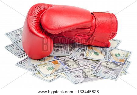 Red boxing glove on top of dollars bills isolated on white background