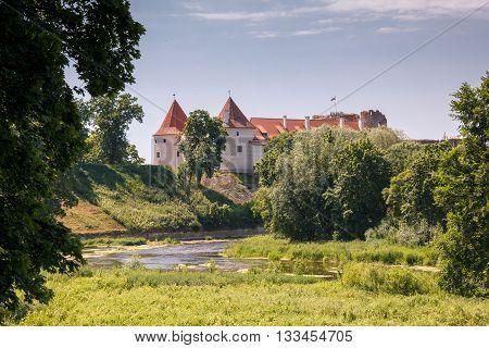 An old Bauskas castle in Latvia in rural surroundings