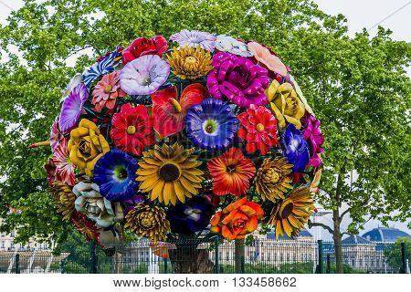 LYON, FRANCE - MAY 16, 2015: This sculpture consists of eighty-five plastic flowers about one meter in diameter forming a spherical crown.