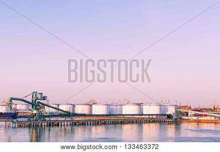 Oil bunkers at Marina in Ventspils at sundown. Ventspils a city in the Courland region of Latvia. Latvia is one of the Baltic countries