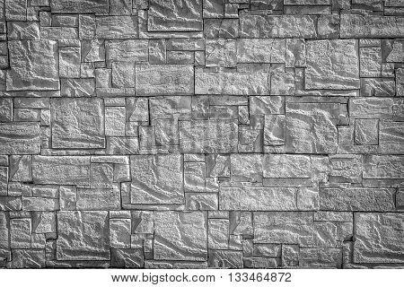 Aged grey brick wall. Abstract texture background.