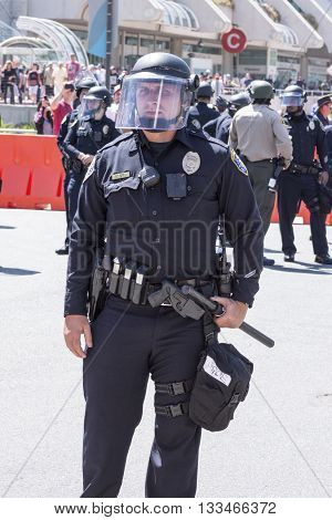 SAN DIEGO USA - MAY 27 2016: A San Diego police officer stands ready in riot gear at an anti-Trump demonstration outside a Trump rally at the San Diego Convention Center.
